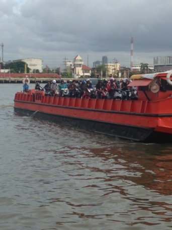 Motorcycle ferry to cross the river